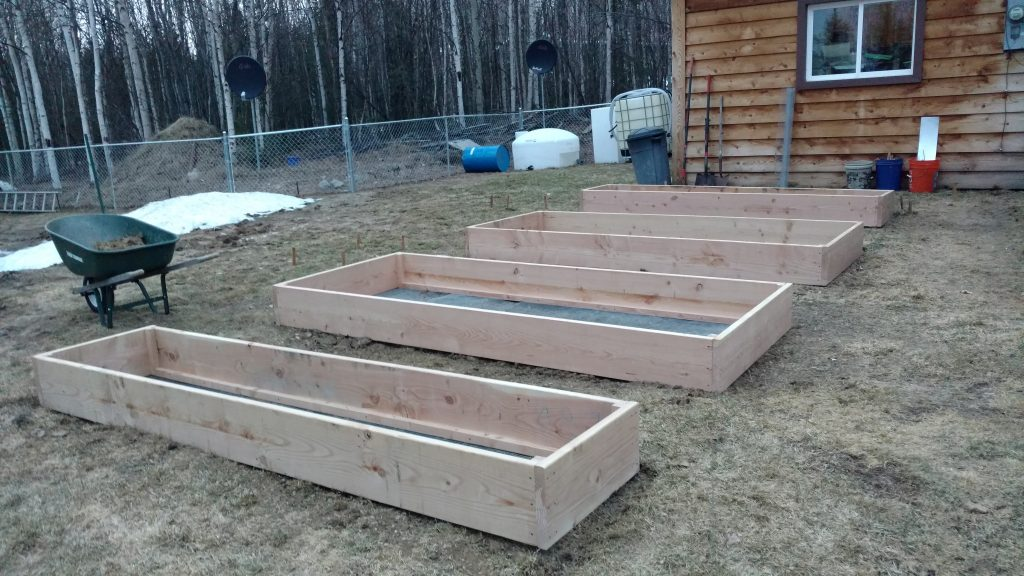 Four of our six garden beds installed and leveled